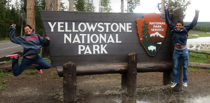 Jump shot in front of Yellowstone sign