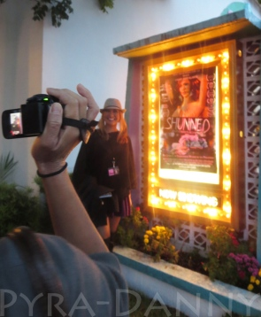 Villarosa stands in front of her movie's poster