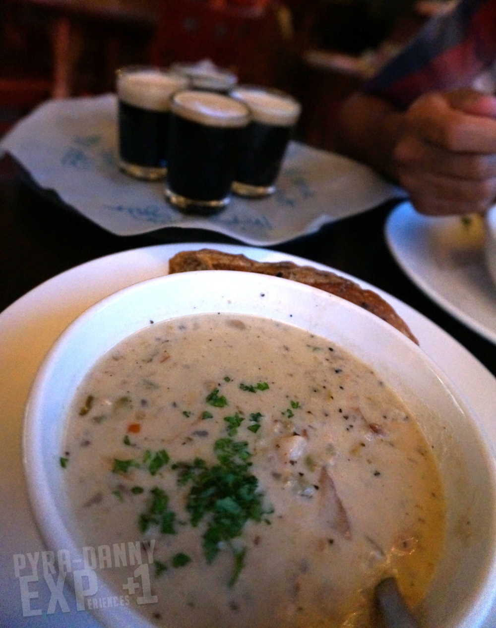 Clam Chowder in front of a beer flight from Oyster House Brewing [Eating Up the Asheville Scene | PyraDannyExperiences.com]